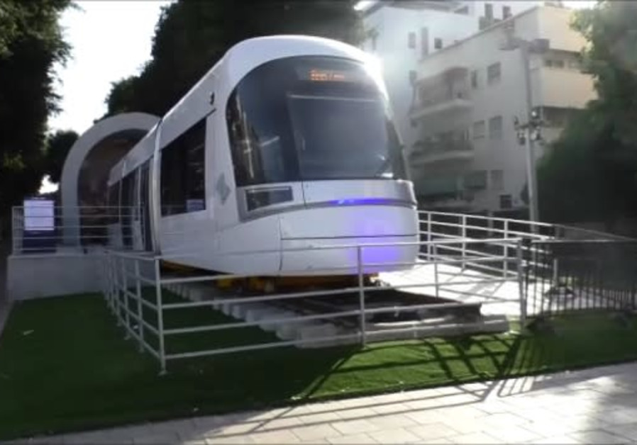 Light rail train car on display in central Tel Aviv.