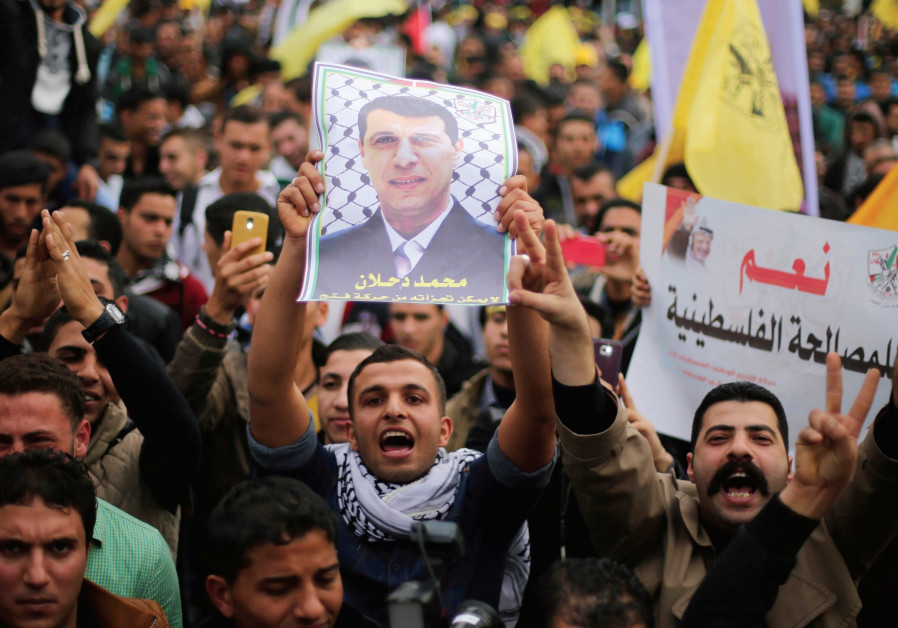 PALESTINIANS HOLD a poster of Mohammed Dahlan at a rally in Gaza city in 2014.