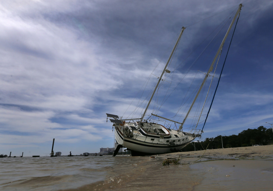 A sail boat is seen washed ashore after Hurricane Nate in Biloxi.