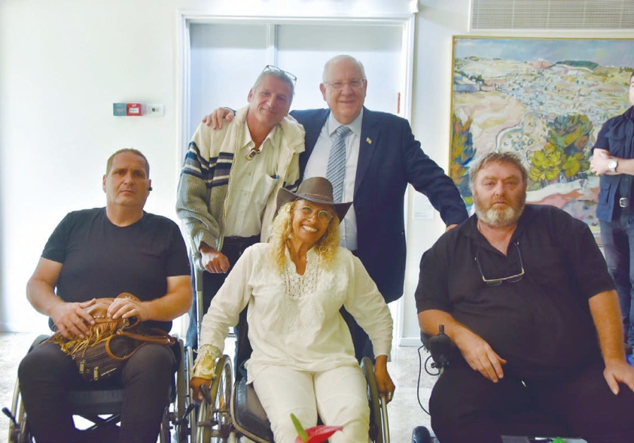 PRESIDENT REUVEN RIVLIN (standing right) meets on Monday with visitors to the annual Sukkot open hou