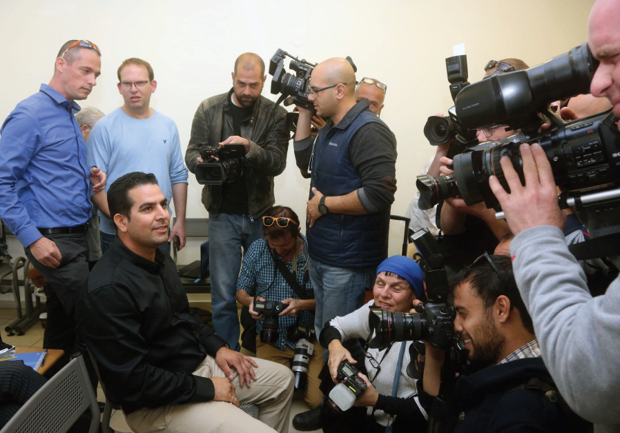 MENI NAFTALI speaks with reporters at a courthouse in Jerusalem in 2014. At the time, he sued the Ne