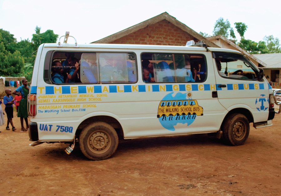 CHILDREN at the Hadassah Primary School welcome their new school bus. )