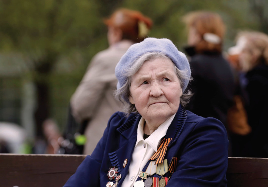 A WOMAN wears her medals during Victory Day celebrations in Riga, Latvia, in 2014, celebrating the v
