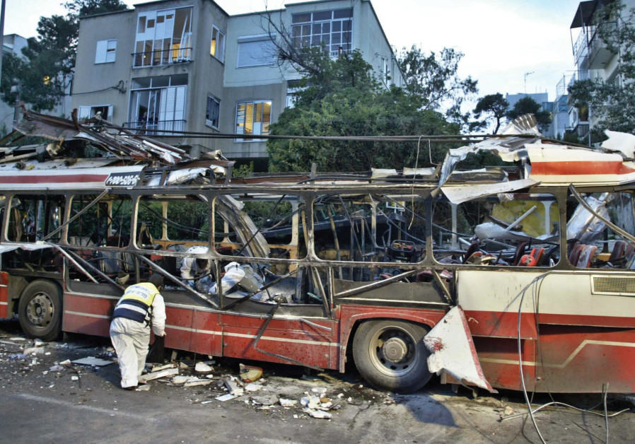 The aftermath of a bus attack in Haifa, 2003