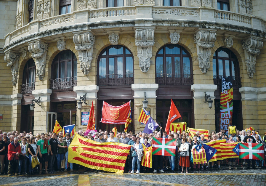PROTESTERS CARRY Esteladas, Catalan separatist flags and Basque flags