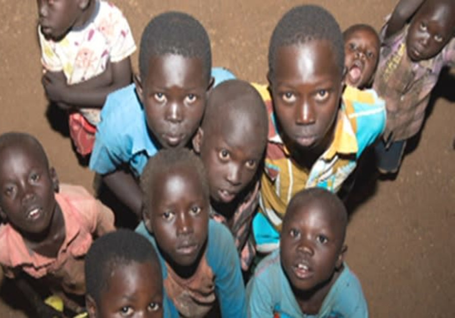 Sudanese children aided by IDF soldiers.