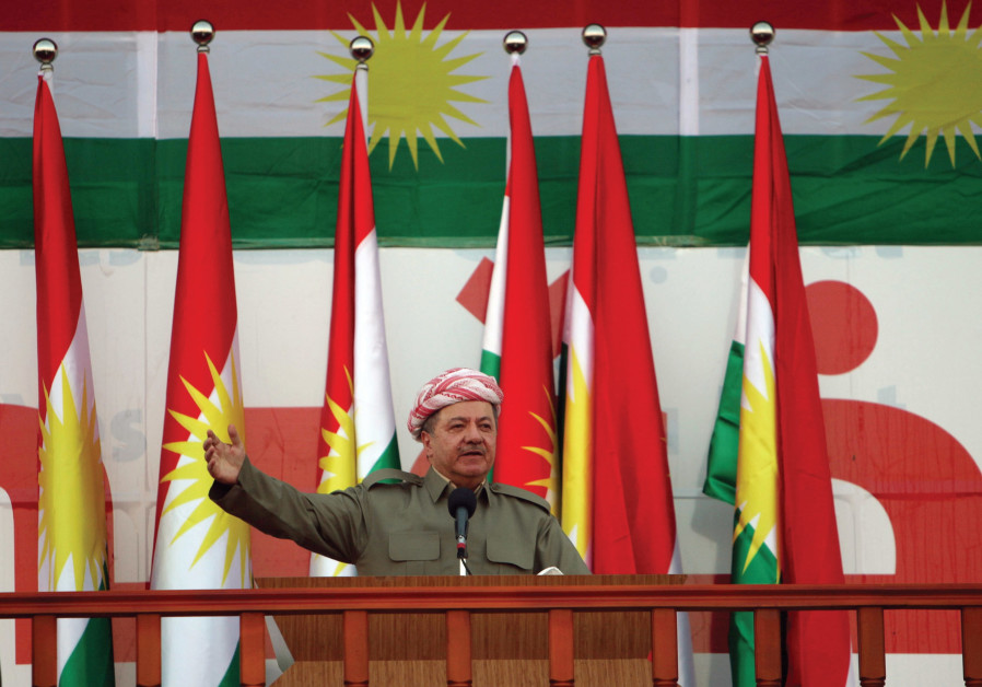 KURDISH REGIONAL Government president Masoud Barzani salutes the crowd while attending a rally befor