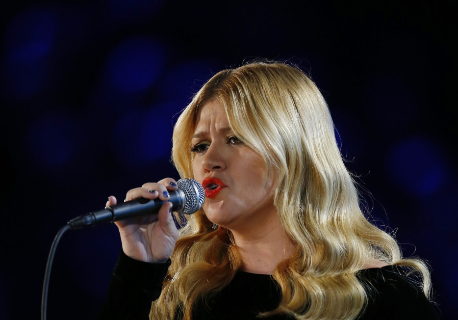 Kelly Clarkson performs at the 55th annual Grammy Awards in Los Angeles.