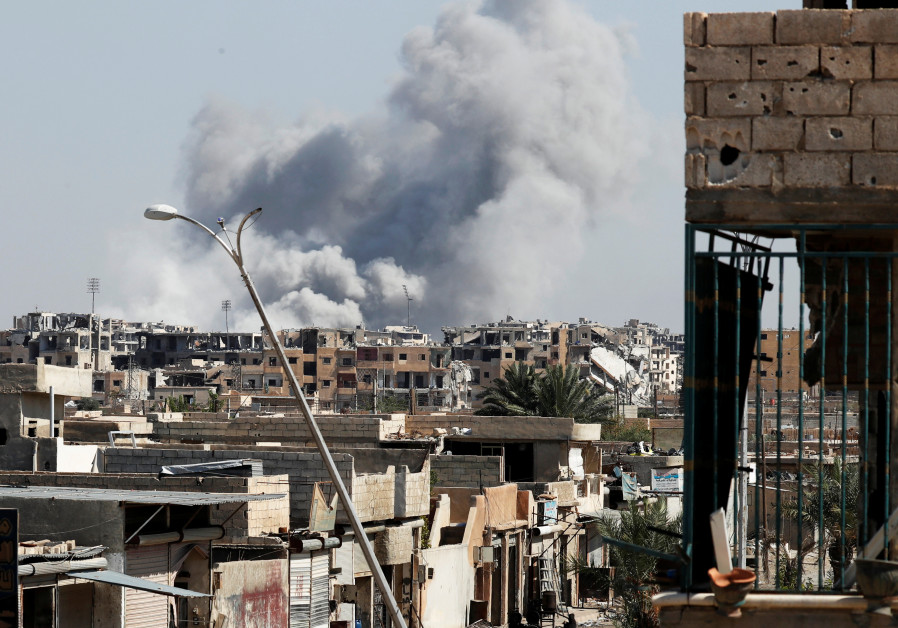 Smoke rises near the stadium where the Islamic State militants are holed up after an air strike by c
