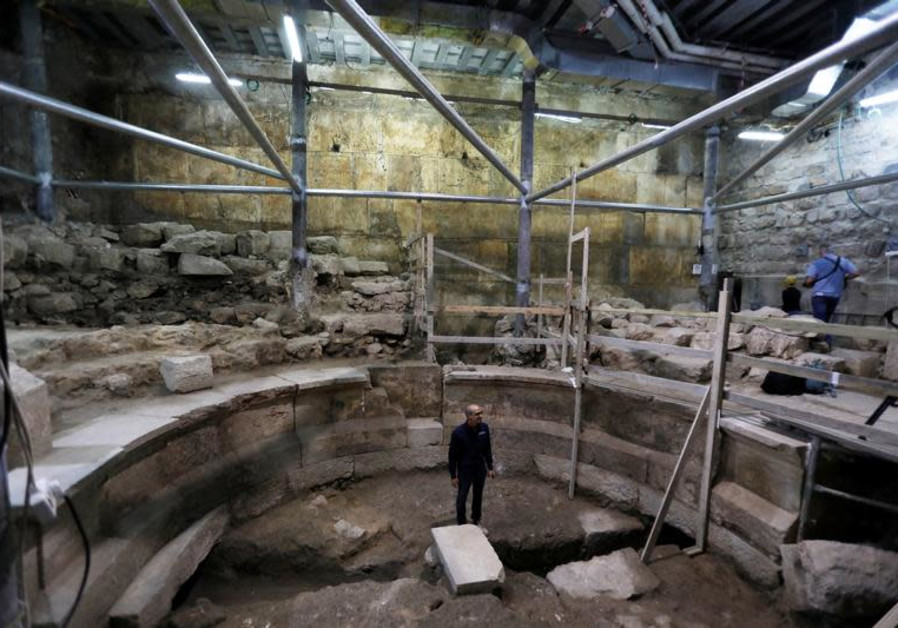 srael Antiquities Authority archaeologist Dr. Joe Uziel stands inside a theatre-like structure during a media tour to reveal the structure which was discovered during excavation works underneath Wilson's Arch in the Western Wall tunnels in Jerusalem's Old City, October 16, 2017. (photo credit:REUTERS/Ronen Zvulun)