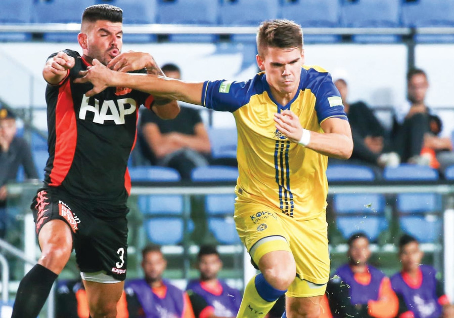 Maccabi Tel Aviv striker Vidar Orn Kjartansson (right) scored his team's opener in last night's 2-0