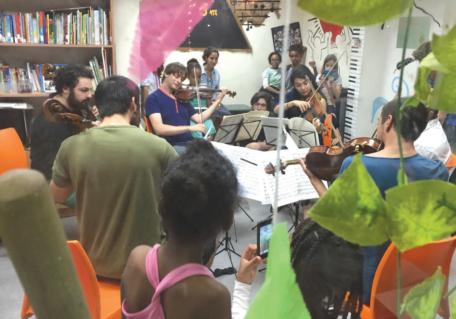 MUSETHICA MUSICIANS play in front of a group of children in Israel.