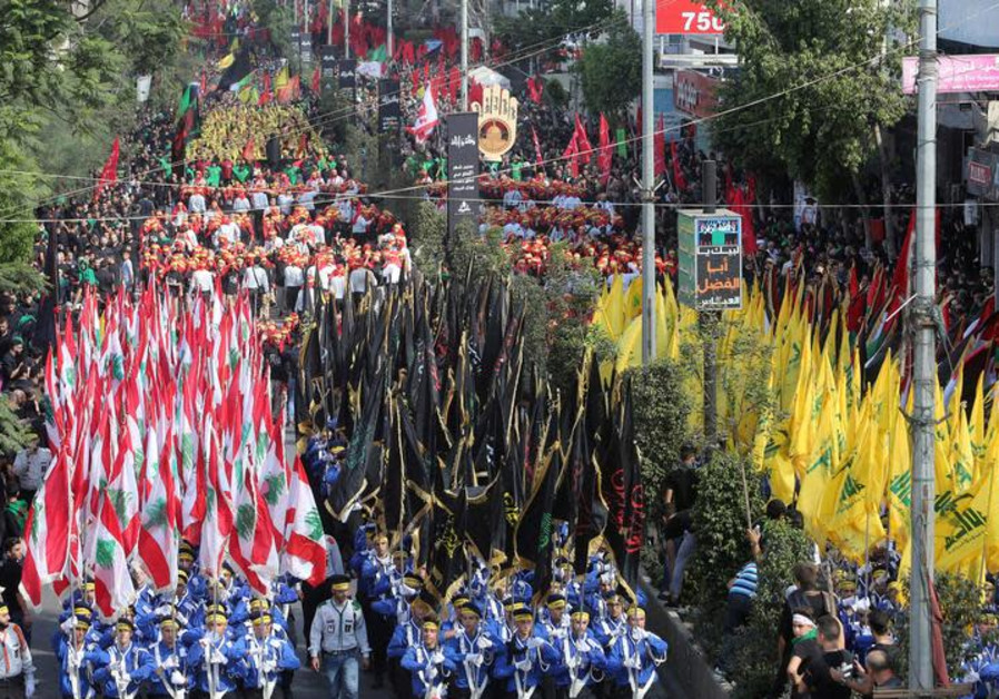 Supporters of Lebanon's Hezbollah party parade to mark the last day of Ashura ceremony in Beirut, Le