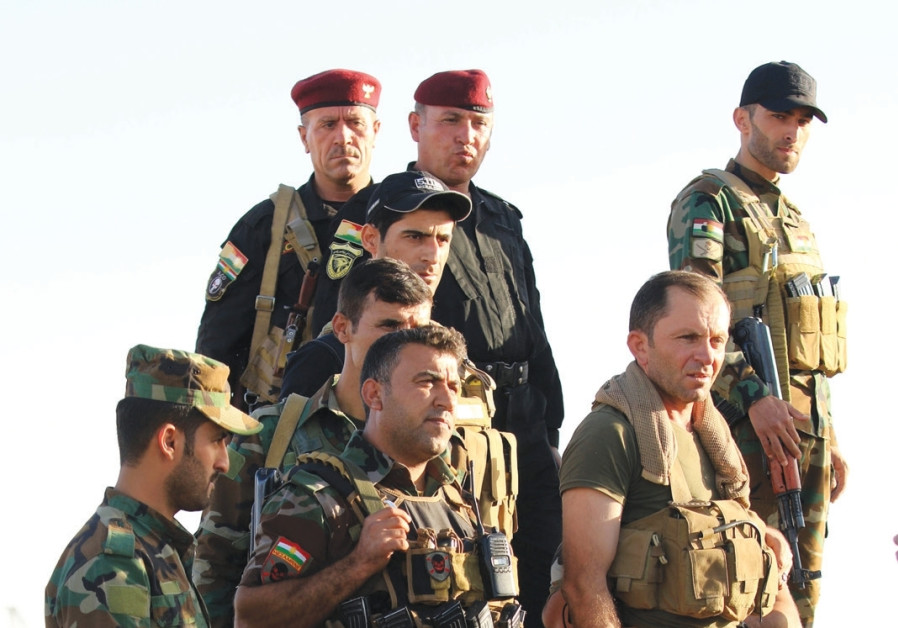 Iraqi army attacks Kurdish forces on road to Erbil