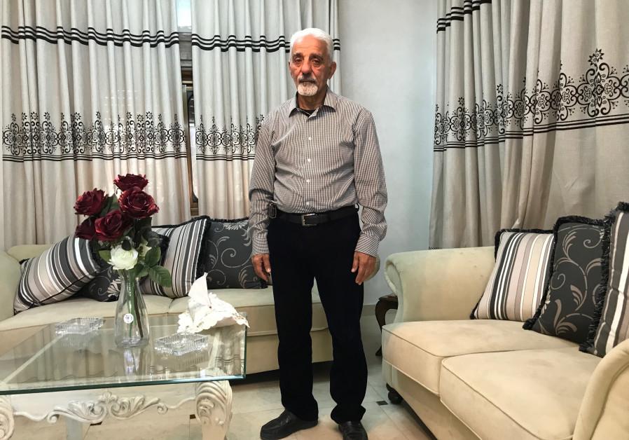 "Mounir ""Abu Ashraf"" Zghayer in his living room in Kafr Aqab. (Udi Shaham)"