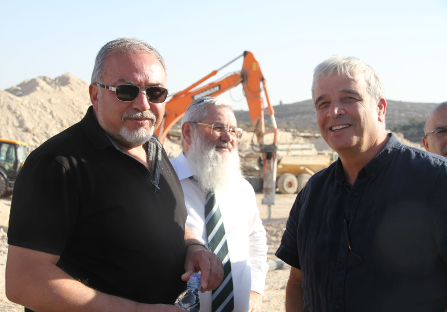 Defense Minister Avigdor Liberman, Deputy Defense Minister Eli Dahan and Settler leader Avi Ro'eh at