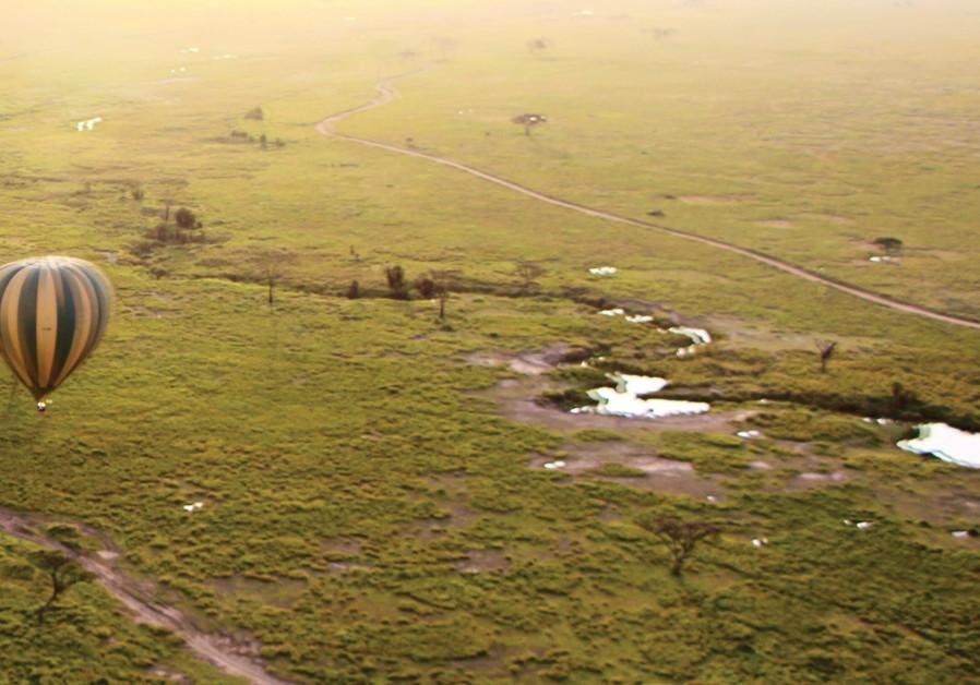 A hot-air balloon hovers over Tanzania.