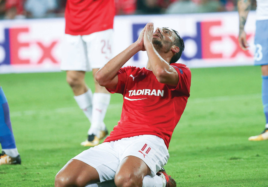 Hapoel Beersheba's Dan Einbinder prays for help at Turner Stadium, with the Israeli champion losing