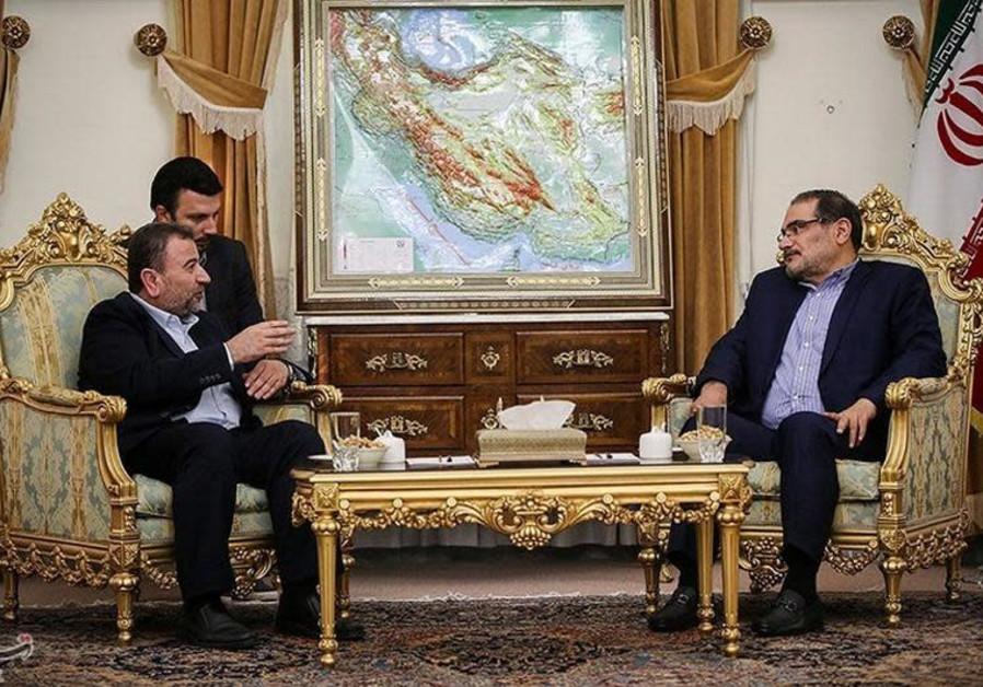 Saleh al-Arouri (L), Hamas deputy chief, meets with Ali Shamkhani, secretary of Iran's National Secu