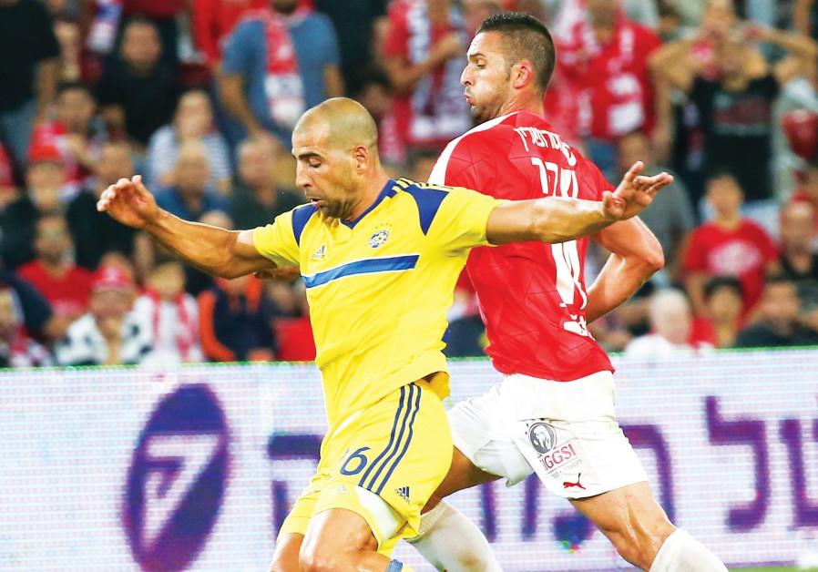 Maccabi Tel Aviv defender Tal Ben-Haim (left) and Hapoel Beersheba striker Ben Sahar (right) will cl