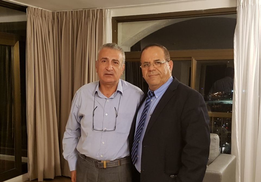 Communications Minister Aoub Kara meets with Syrian opposition leader Kamal Laboani in Jerusalem