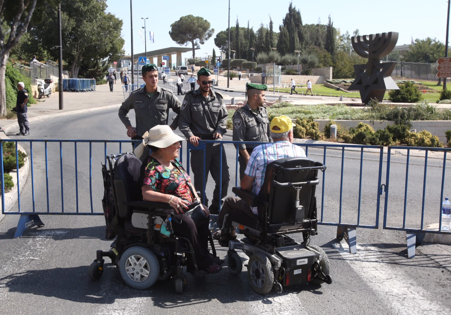 Disabled Israelis protest outside the Knesset, October 2017