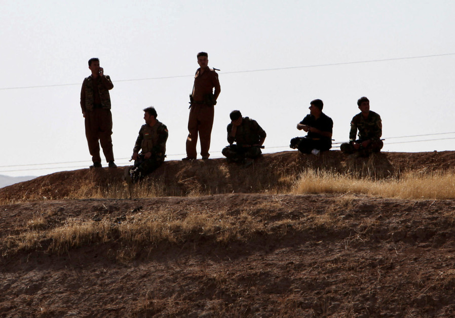 Kurdish Peshmarga forces are seen near Altun Kupri, between Kirkuk and Erbil