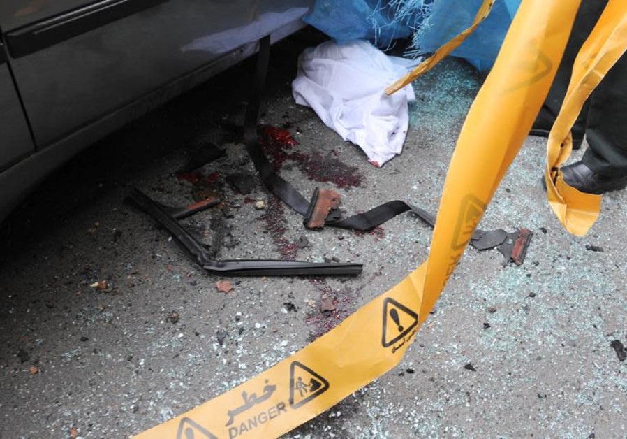Bloodstains are seen next to the car belonging to Iranian nuclear scientist Mostafa Ahmadi-Roshan a