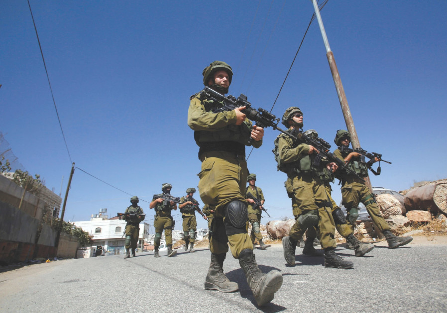 SOLDIERS ON patrol in the West Bank.