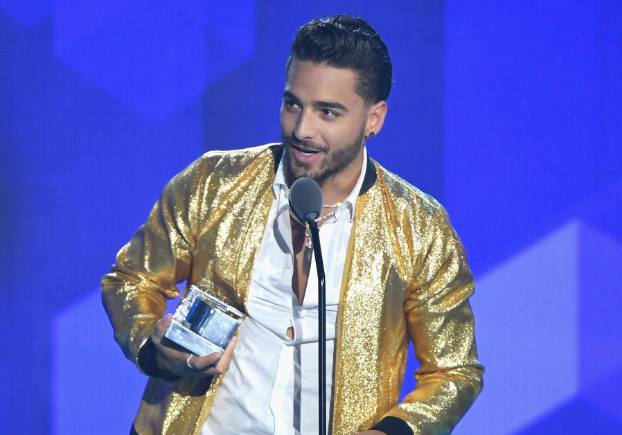 "Maluma accepts an award on stage during Univision's ""Premios Juventud"" 2017"