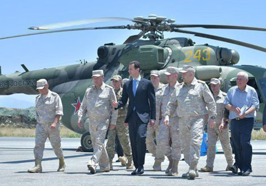 Syria's President Bashar Assad visits a Russian air base at Hmeymim, in western Syria in this handou
