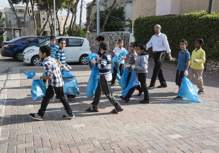 Meir Weizman and his students take part in Clean Up Day activities