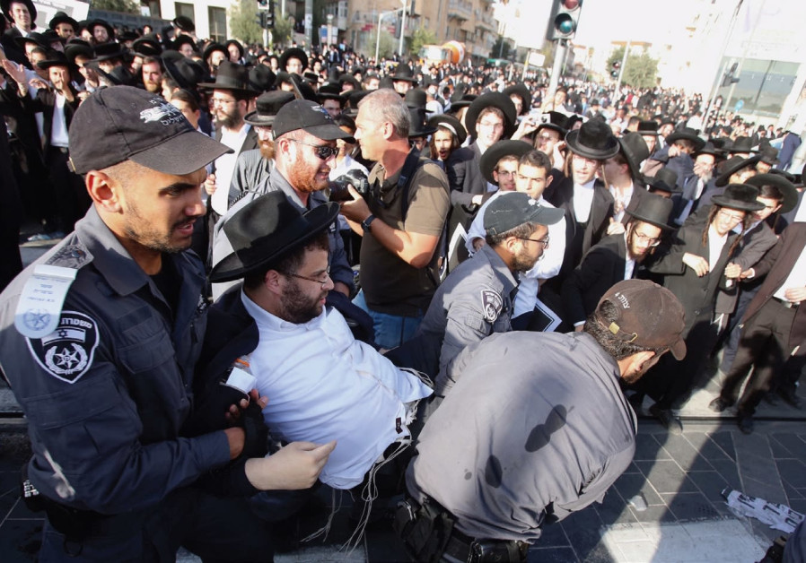 POLICE APPREHEND a man during last week's 'day of rage' protest in Jerusalem.