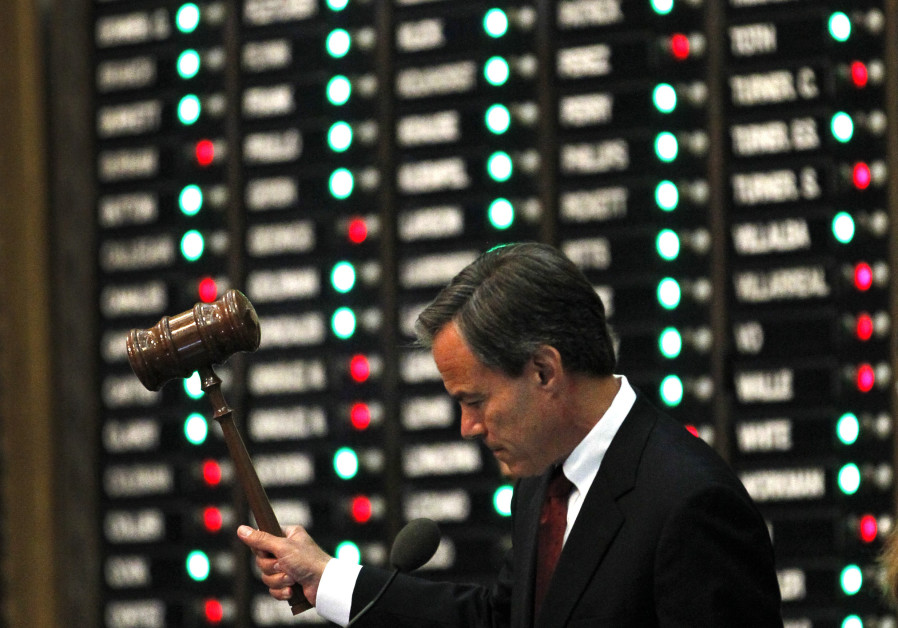 Texas Speaker of the House of Representatives Joe Straus bangs his gavel.