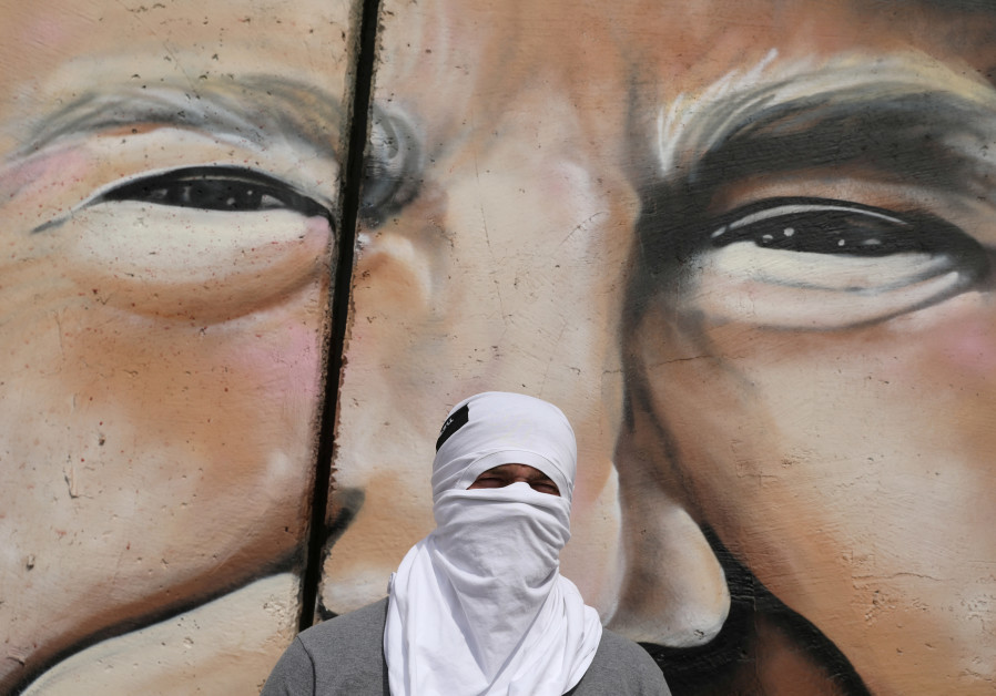 Lushsux in front of mural (Credit: Ammar Awad/Reuters)