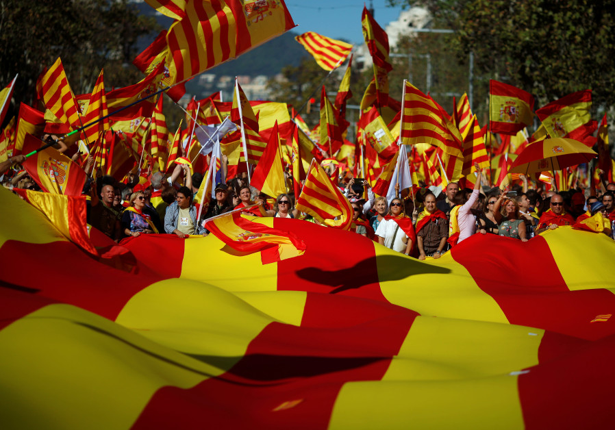 Pro-unity supporters take part in a demonstration in central Barcelona, Spain