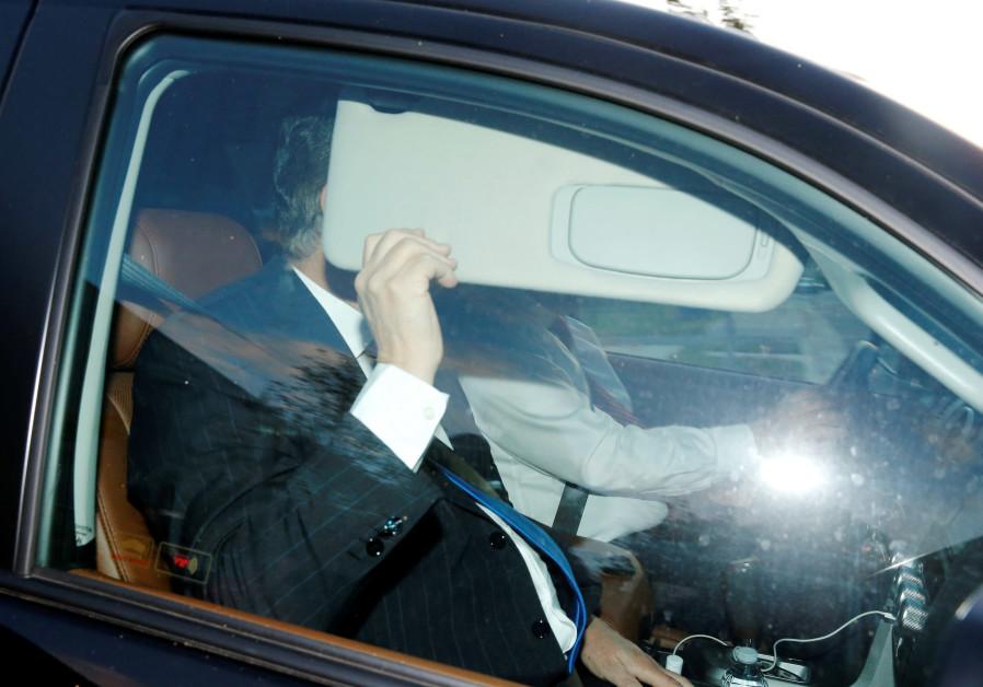 Former Trump campaign manager Paul Manafort hides behind his car visor