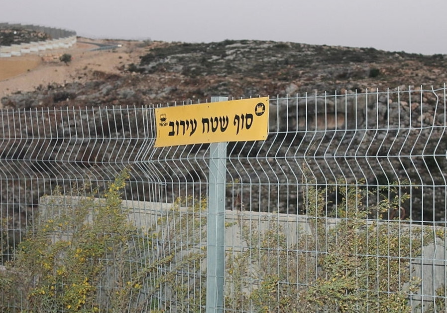 An eruv wire seen at the edge of a settlement