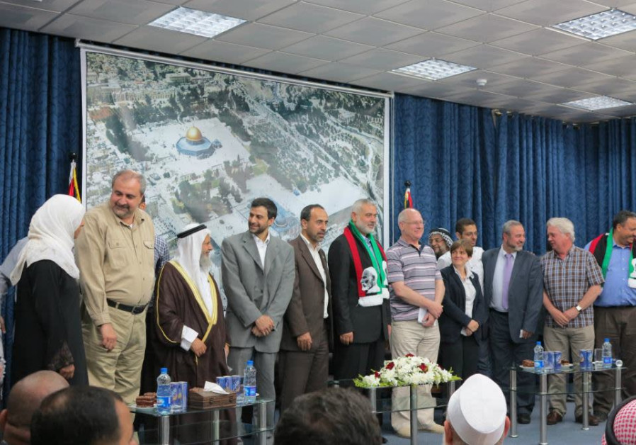 PSC Chairman Hugh Lanning (second from the right) standing with Hamas Cheif Ismail Haniyeh (center).