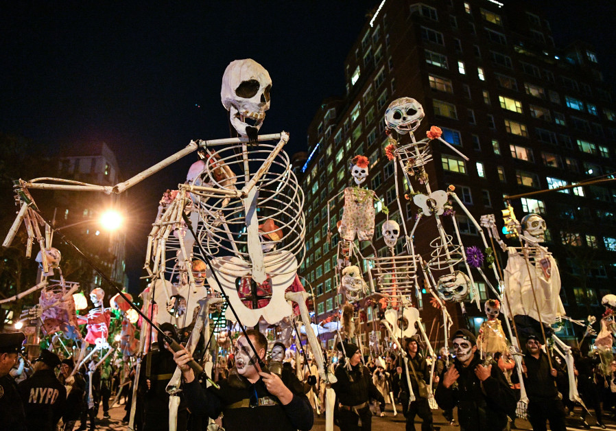 Halloween revelers attend the Annual Village Halloween Parade on October 31, 2017 in New York City