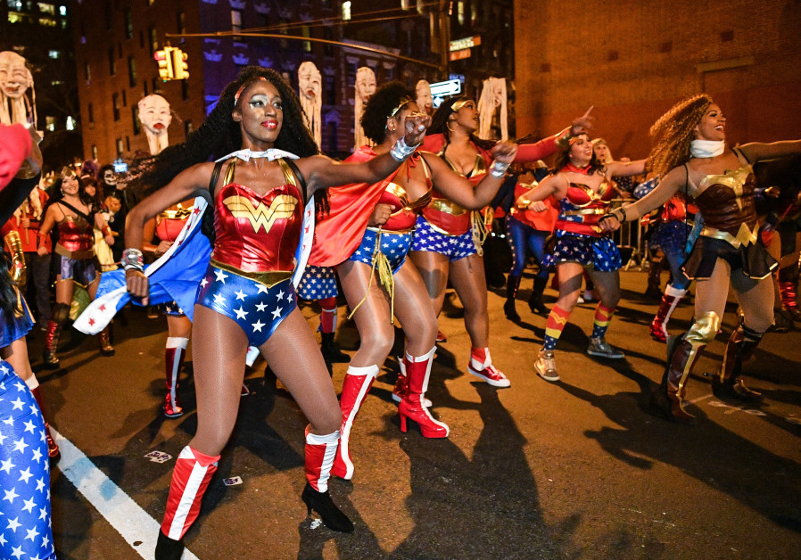 Women dressed as Wonder Woman celebrate Halloween on October 31, 2017 in New York City