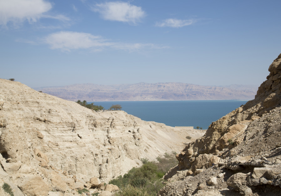 A desert canyon leads in to the Dead Sea