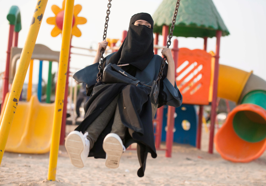 A Saudi woman swings at a park in Jeddah