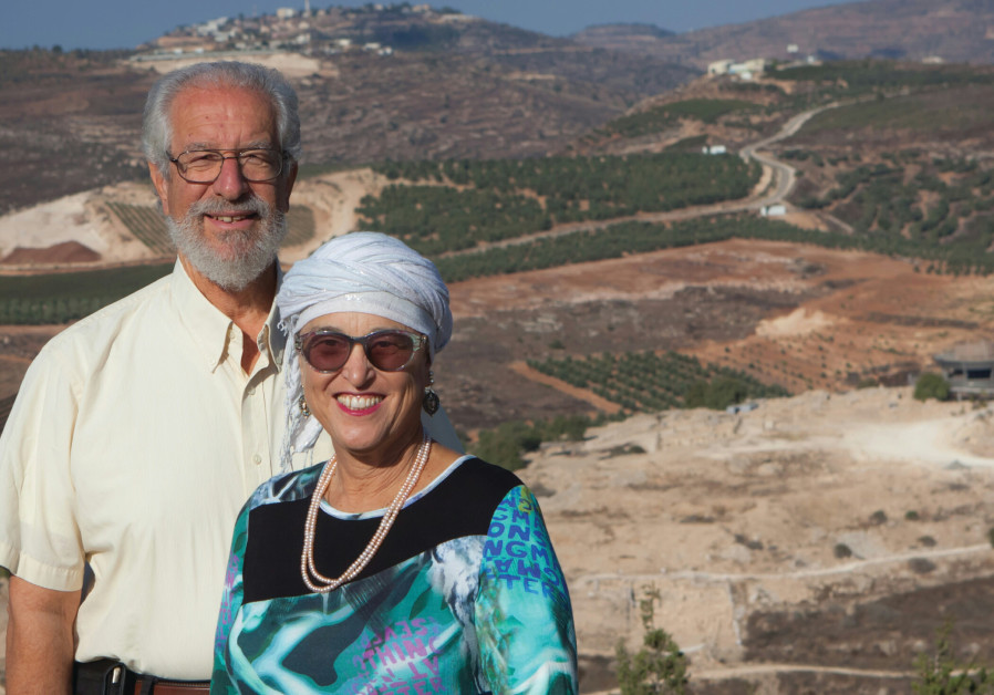 YISRAEL AND BATYA Medad on a hill overlooking Tel Shiloh and the Shiloh vineyards