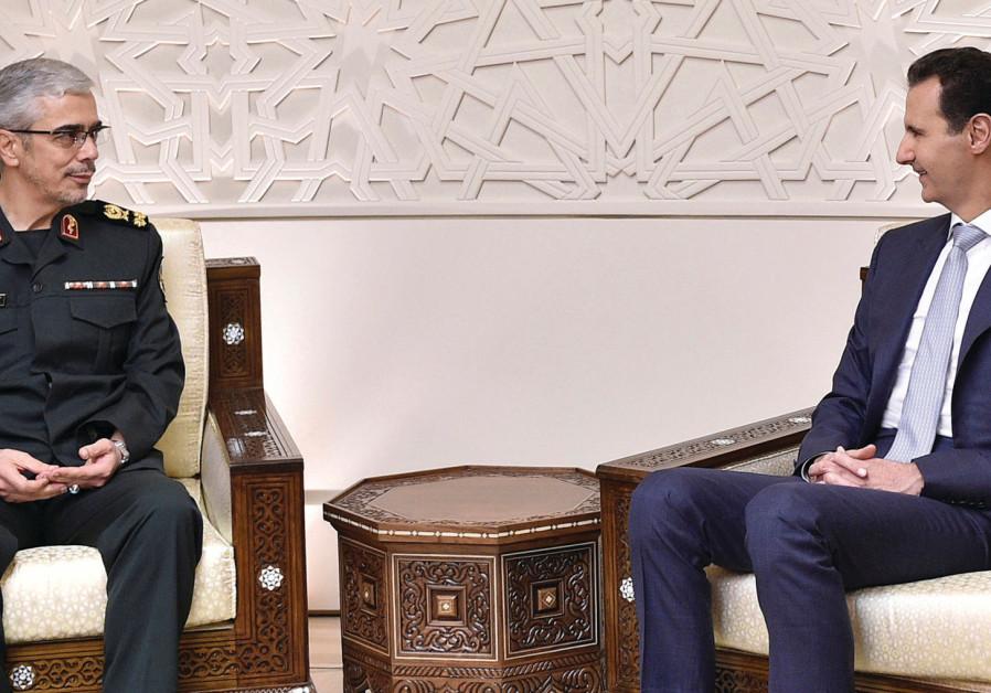 Syrian President Bashar al-Assad (right) meets Iran's military chief, Gen. Mohammed Baqeri, in Damas