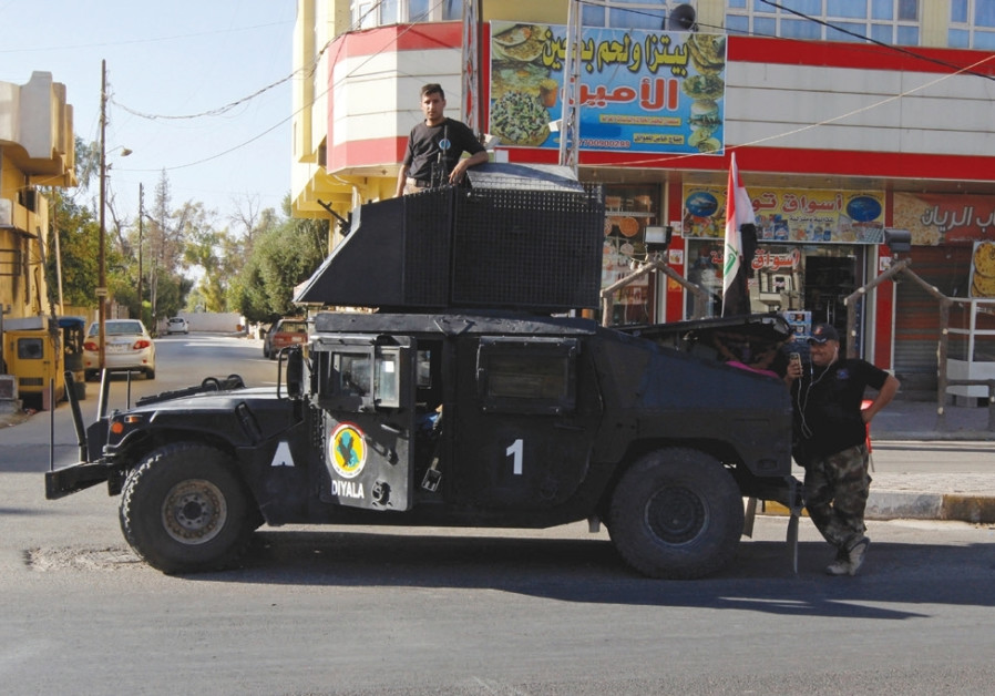 A VEHICLE of the Iraqi Federal Police is seen on a street in Kirkuk last month.
