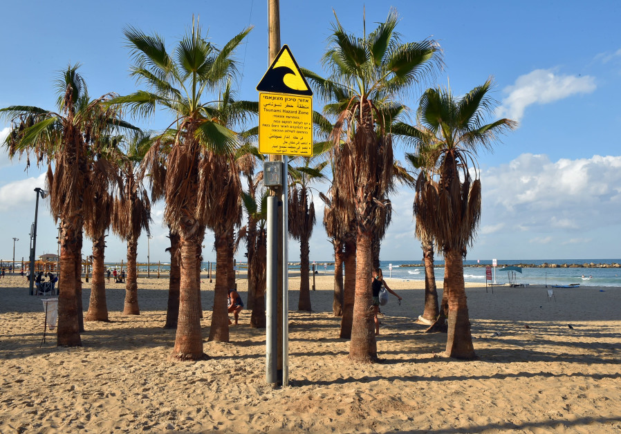 Tsunami warning signs being placed on beaches throughout country