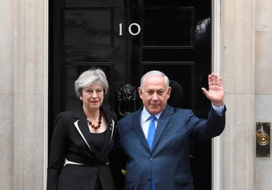 Britain's Prime Minister Theresa May welcomes Israel's Prime Minister Benjamin Netanyahu outside 10 Downing Street in London. (TOBY MELVILLE/REUTERS)
