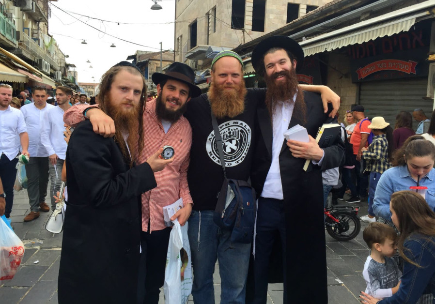 Eitan Press (center right) stands with the band Zusha and their manager. ( Zachariah Goldschmiedt, P