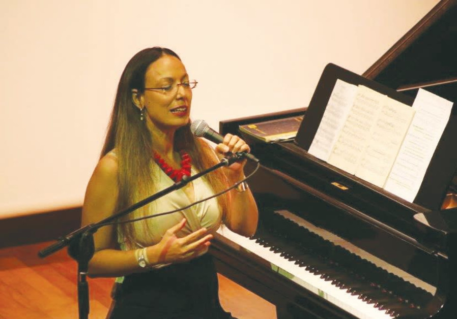 Orit Wolf takes a break from the piano to serenade her auidence